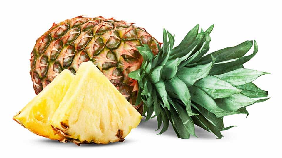 a whole pineapple and two pineapple slices