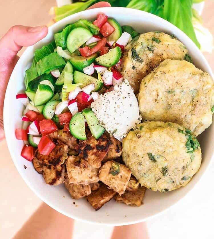 bowl with veggies, chicken and potato cakes